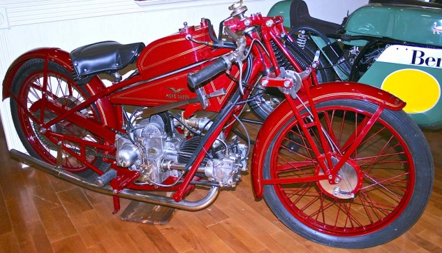 Old Guzzis have a special place in the hearts of old racers. Unlike the production models, this 1924 CV4 sported a 4-valve head and overhead cam. The horizontal 500cc Single kept weight low in the chassis. External flywheel is visible behind carburetor.