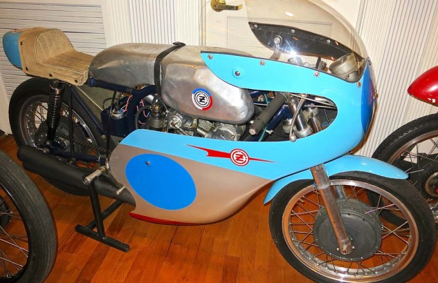 : CZ built 125 and 250cc DOHC Twins in the '60s. When the Czechs changed the rules to allow only 2-strokes in the 250 class, CZ bumped the twin to 320 to run in the 350 class, where it had to contend with the Jawa Twin and Honda Four