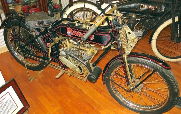 A 1922 Swiss motorcycle, the Motosacoche was creatively restored by in the '80s by the elgendary Von Dutch, who chose a French theme for the graphics. What appears to be brass plating is actually tobacco tar collected over two decades on display in the San Francisco bar Eddie Rickenbacker's.