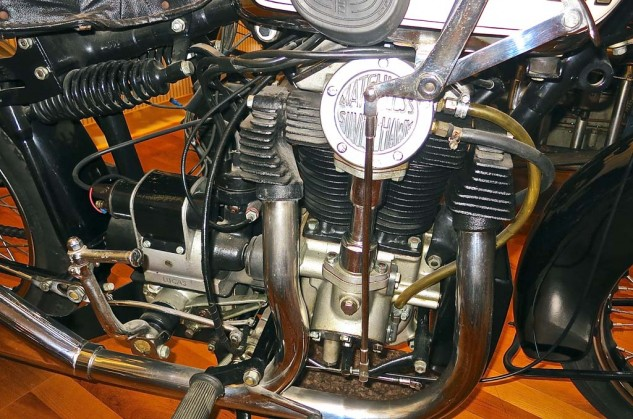 The 1933 Matchless Silver Hawk had a bevel-drive overhead-cam V-4, in a common cylinder casting. Swingarm suspension with shocks below seat.