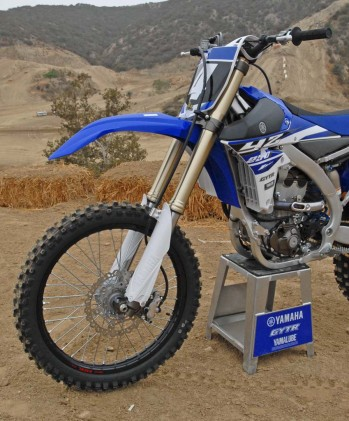 Yamaha continues to resist the air-sprung fork trend in motocross and stick with a proven coil-spring design. The YZ250F's KYB fork features Speed-Sensitive damping cartridges with revised settings for 2015. Suspension travel is 12.2 inches up front. The fully adjustable KYB piggyback reservoir shock out back provides 12.4 inches of travel.