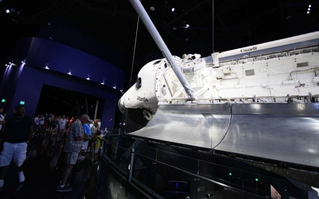 The space shuttle Atlantis on display at the Kennedy Space Center's Shuttle Launch Experience. Its final flight in 2011 marked the end of the space shuttle program in which 135 shuttle missions were launched.