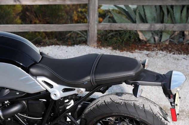 The nineT's seat is quite attractive, especially with its hand-sewn white stitching and the forged aluminum brackets which support the midsection of the saddle.