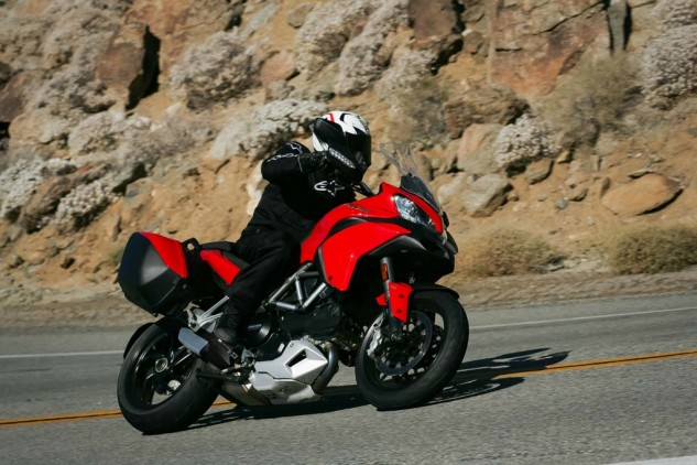 The Ducati Twin throbs at 80 mph/4,500 rpm in top-gear. Its handling demands you keep pressure on the inside bar through sweeping corners. Short legs beware, the Multi's seat is claimed to be 33.5 inches from the ground and feels even taller.