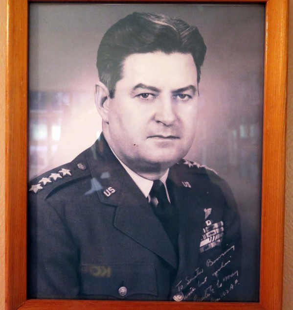 General Curtis LeMay is just one of many framed heads of the famous and crazy on Sen. Bowring's walls.