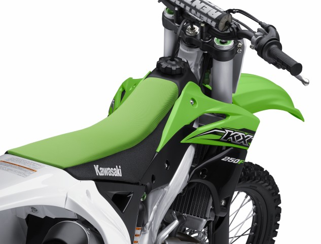 The KX250F's slim seat hides its new KX450F-style subframe, which is narrower and lighter than the 2014's. Naturally, all-new graphics adorn both machines.