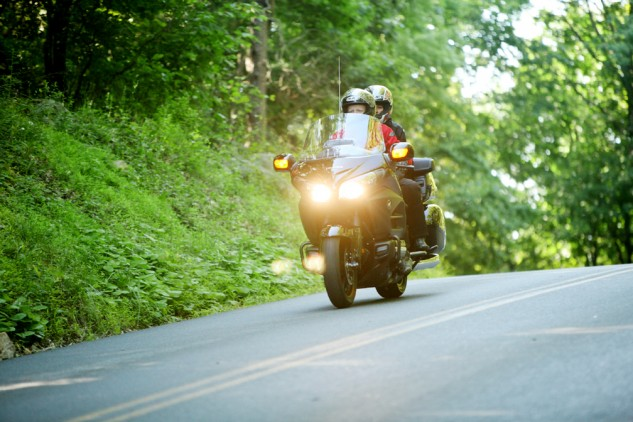 Photo by Matt Armstrong. Life, Liberty and the Pursuit of Happiness. No better way to celebrate the Fourth of July than good company, a solid motorcycle and a winding road.