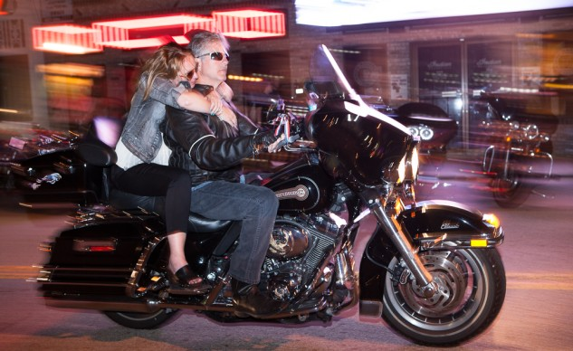 Helmetless couple Daytona Bike Week night