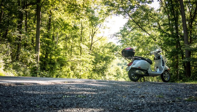 Central Pennsylvania has some of the best riding roads in America. Here the Vespa pauses during a ride along Spring Creek, a favorite with trout fishermen.