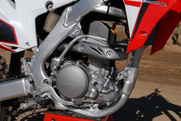The CRF250R's fuel-injected four-stroke Single is now easier than ever to tune to track conditions, thanks to a new Engine Mode Button feature that allows the rider to switch between three different EFI/ignition maps. Mode 1 is for the stock ignition and fueling, Mode 2 is for slick surfaces, and Mode 3 is for tacky or deep surfaces.