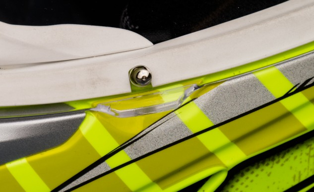 This remarkably simple visor latch offered positive feedback when fully closed.