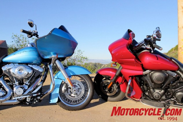 We conducted a shootout between Kawasaki's Vulcan 1700 Vaquero and H-D's Road Glide a few years ago,. Both have frame-mounted upper fairings, but the Vaquero's swoopy lines and fairing lowers (shrouding the liquid-cooled motor's radiator) present an altogether different-looking bike compared to the Road Glide.