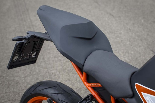 What looks like a matte-black tailsection is actually a pillion seat made of a Canadian-sourced material that is used on a motorcycle for the first time ever. Grab handles are nicely integrated beneath.