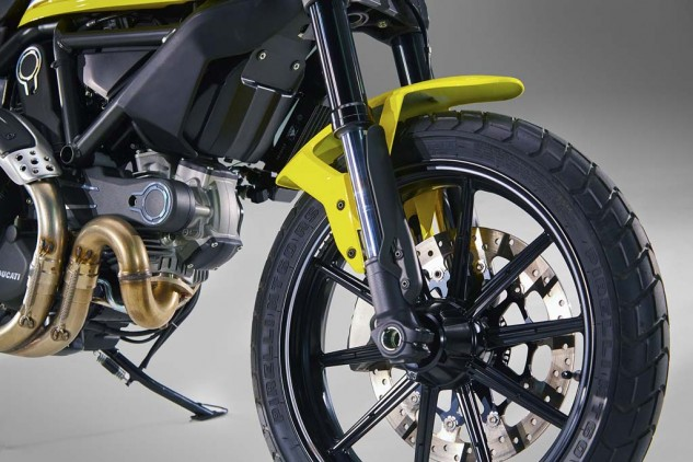 A single front disc brake shows off the right side of wheels unique to the Scrambler.