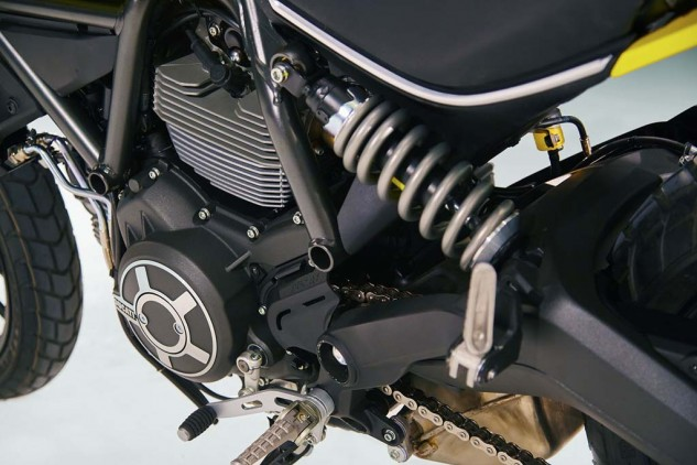 The Scrambler's aluminum swingarm acts directly on a preload-adjustable shock. Interestingly, a gray shock spring is used rather than Ducati's traditional yellow springs.