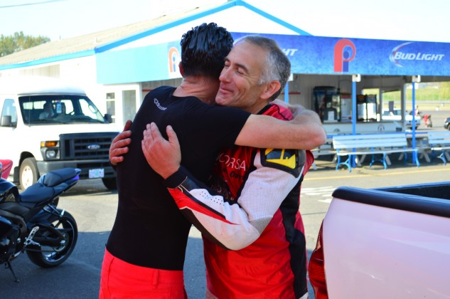 "Czysz embraces long-time friend, and six-time OMRRA champion, Shawn Roberti. ""He's one of a few guys I trust implicitly to be inches from my rear wheel,"" Czysz says."