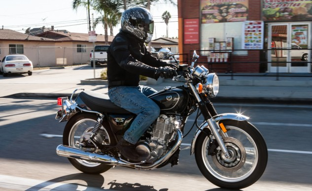 In real-world riding, the SR's seat is decently padded for around-town expeditions and errand running. The bike feels narrow overall and the front disc/rear drum brake setup is more than adequate for the job.