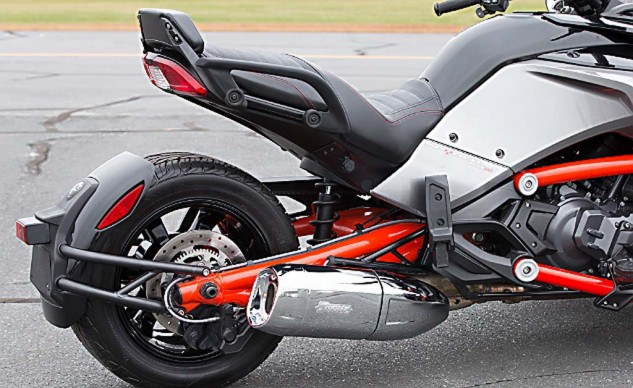 Passenger seat accommodations are roomy and feature large, rubberized grab handles. Passenger footpegs, however, have no stops and when in the up position contact the side panels, scoring the plastic. The small backrest shown here is one of many available F3 accessories, as is the chrome akrapovic muffler.