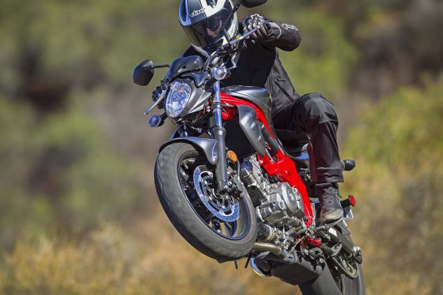 """Its 90-degree V-Twin is more pleasing and smoother than the parallel-Twins,"" says EIC Duke mid-wheelie, ""emitting a sweet aural signature that could fool many a Ducatista."""