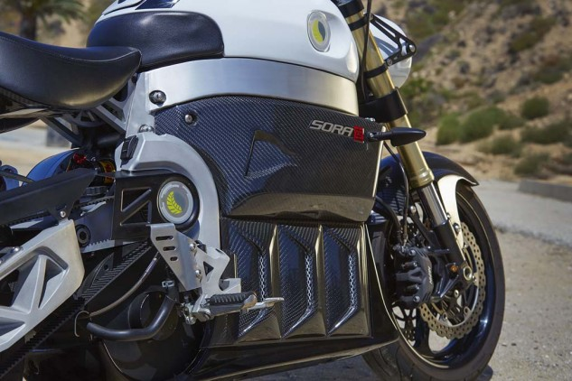 The Sora features a reverse gear! Very handy for a 573-pound machine. The Forward, Neutral, Reverse switch atop the right frame spar is, however, inconveniently located. Carbon fiber bodywork changes to plastic at the areas most likely to incur rock chips.