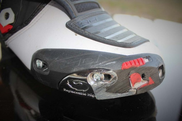 The sad shape of these toe sliders resulted from my wonky ankle not allowing an optimum position on the footpegs of KTM's RC390. A new fiberglass-reinforced nylon slider ($19.50) and metal slider insert ($11.25) will restore these boots to like-new status.