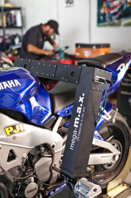The German-built MegaMax device measures a frame with no disassembly required. It slips into the swingarm pivot and uses lasers to determine straightness. Or lack of.