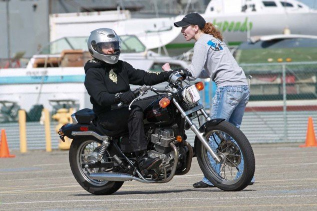 MSF RiderCoach Heidi Burbank coaches a student through a turn. Yes, she knows the throttle is on the right.