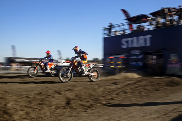 As an added element of suspense, each competitor lines up at the starting gate like a traditional motocross race, but neither racer can see the other until they launch.