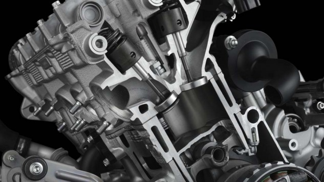 The new R1's engine features a magnesium oil pan, engine covers and cylinder head cover
