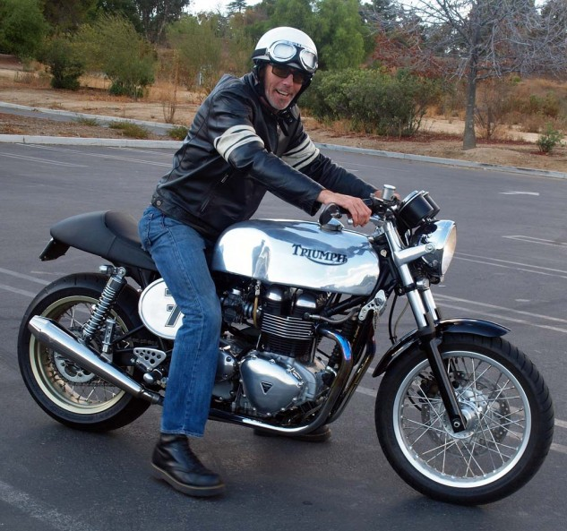 "Originally from London, Gary Rowley is all grins aboard his 2005 Thruxton that sports a custom alloy tank by Terry ""T.A"" Baker of Tab II Classics located in Wales who has built more than 2,000 tanks for many different bikes."