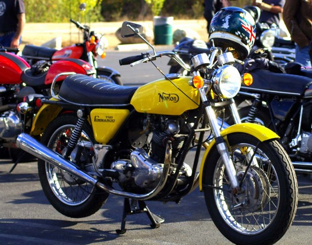 Very tasty Canary Yellow 750 Commando with sweet-singing Dunstall pipes.
