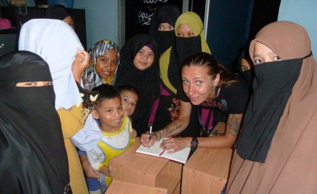 Anna with kids in Malaysia