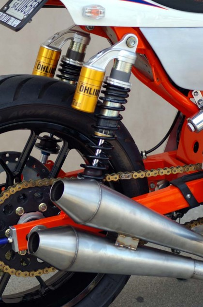 "A pair of Ohlins shocks are worth their weight in golden handling. Custom megaphones are perfect ""trumpets"" for the SBT Tracker."