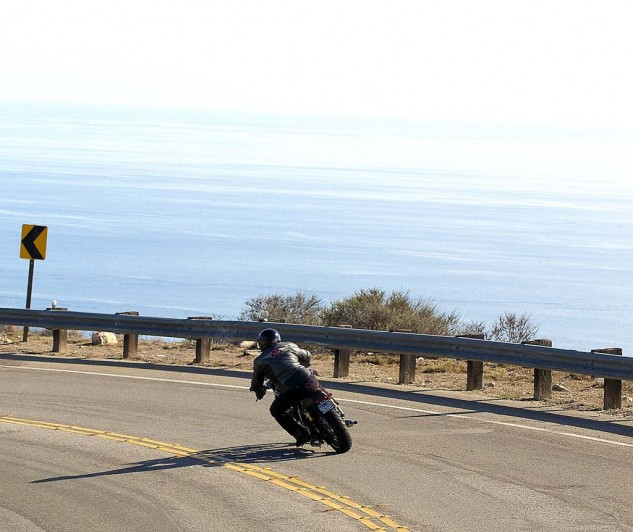 SBT's crewmember Teren takes the Triumph Bonneville record breaker through the ocean-side twisties.