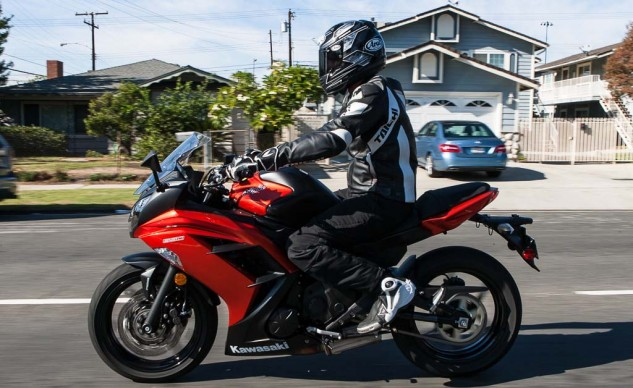 The Ninja is a very favorable motorcycle from the waist up. The bars place you virtually upright, and decent wind deflection is given from the screen. However, the high pegs present a tight squeeze for those with long legs.