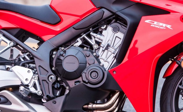 """Honda's all-new CBR650F also comes with an all-new engine. The """"CB400F-inspired header design looks sexy, what little of it is seen,"""" says Duke. It put out the most power in this test but emits an annoying buzz through the bars. Still, it returned 42.5 mpg average during our testing, better than the 41.8 mpg of the Kawasaki and 38.4 mpg of the Yamaha."""