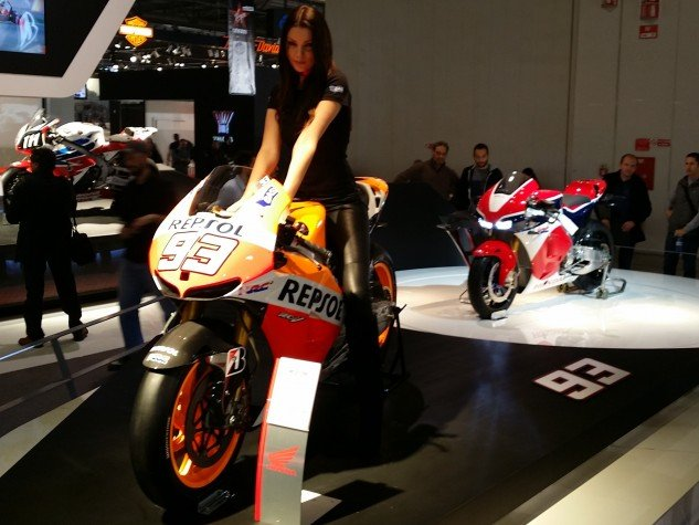 We're dying to find out more about the stunning red-white-and-blue RC213V-S MotoGP-based streetbike, but Honda is keeping its lips tight. The prototype at EIMCA was so guarded that models were allowed to sit on one of Marc Marquez's GP bike but not the the precious RC213V-S. (Photo by Sean Alexander)