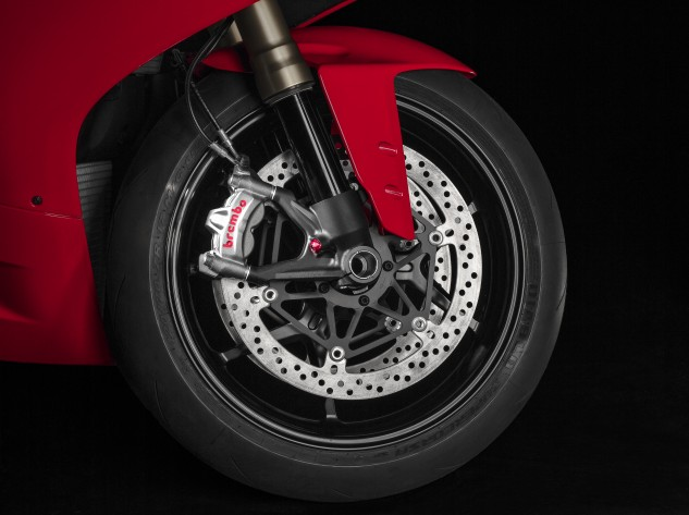 The Brembo M50 calipers latch onto 330mm discs, but the big news is the addition of Cornering ABS.