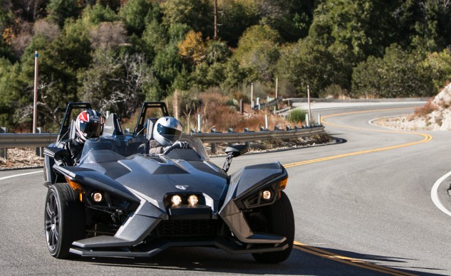 The Slingshot provides the best wind protection, has adjustable seats, adjustable steering column, and cruise control. The Spyder F3 also has cruise control, but the Morgan does not.