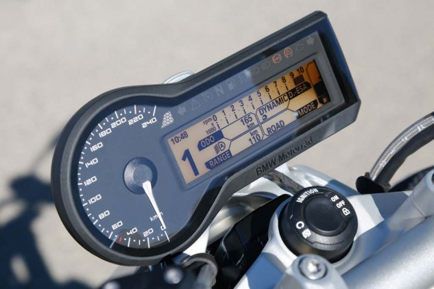 "An analog speedo is accompanied by a TFT display packed with information from the onboard computer that you can reduce to not so much in ""Tourist"" mode. The tach's too small to read, but who needs it with a big grunty Twin? A light sensor automatically adjusts for ambient light, and day and night designs."