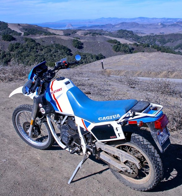 "The Cagiva Elefant, with ""Soft Damp"" suspension, grew within five years to a brawny 900cc rally bike, ridden to victory in the 1990 Paris/Dakar event by Edi Orioli. The production dual-adventure-sport-scrambler-touring-trailie was dubbed the 900e. Subsequently, the stylish Gran Canyon. emerged, which would effectively be the last Ducati ""scrambler."" Until now, 15 years and a few Ducati corporate owners later."