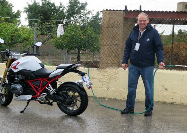 Whatever it takes: BMW Pressesprecher Rudi Probst mans the hose at the R1200R introduction last week.