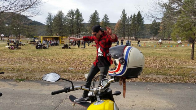 If the Ducati Scrambler experience could be summed up in one picture, this would be it. Ride to a campsite, eat delicious barbecue by a fire, practice your archery, then fool around on your skateboard. While wearing flannel, of course.