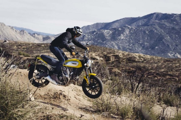 Obligatory Scrambler off-road jumping photo. Unfortunately, that's not me manning the controls.