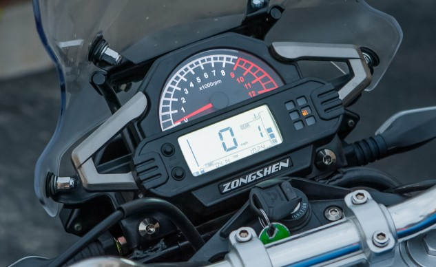The digital speedo has a gear position indicator and a fuel gauge, however, the fuel gauge was showing empty with a half-tank remaining. Idiot lights are small and dim.