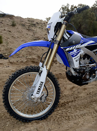 The WR's KYB Speed Sensitive System inverted fork features lighter springs and valving that is more suitable for rolling over rocks than blasting berms.