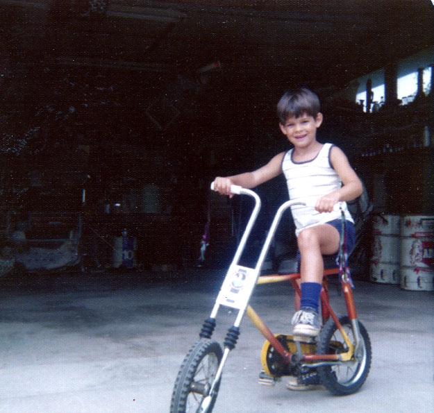 I didn't have an actual motorcycle at five years old, but I got close. Photo was taken prior to addition of the Roar Power accessory or presently fashionable safety equipment.