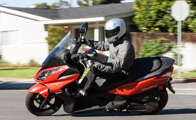 Turn-in is quick on the 300i, but it stops well short of being any kind of sporting scooter.