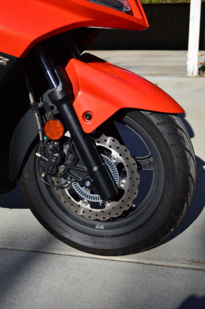 A single wave-type disc at both ends bring the Kymco to a halt rather well. Note the speed sensor ring on the disc. While normally a tell-tale sign of ABS, it's just a cosmetic item on our tester.