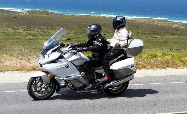My queen rides regally behind me. And here's a tip for riders who want ladies to ride with them: get heated seats like the K1600GTL-E's! Photo by Mary Antus Buch, a wonderful lady despite (or perhaps because) being the wife of the editor of a competing magazine.